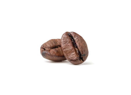 Two fresh roasted dark brown arabica coffee beans isolated on a white background