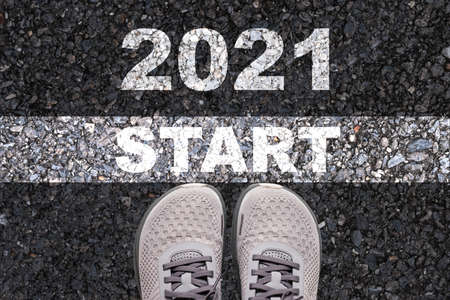 Merry Christmas & Happy new year holiday celebration  and new business starting concept , Shoes on road which print screen start and 2021 wording.