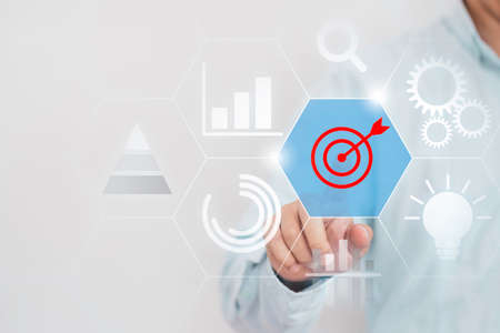 Achievement business target concept , Businessman touching to virtual monitor board which print screen red target dart.