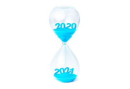 Merry Christmas & Happy new year holiday concept , Beautiful hourglass which contain blue sand flowing down for change 2020 to 2021 on white background.