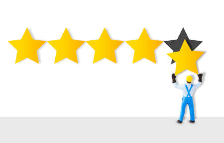 Miniature figure worker staff holding a gold star in hand to give five star for customer evaluation. Customer satisfaction and marketing survey concept.