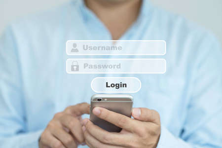 Businessman touching screen of mobile phone and virtual username password to login computer system and smartphone.