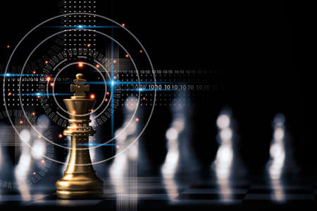Golden king chess stand in front of others chess pieces. Leadership business teamwork and marketing strategy planing concept. Imagens