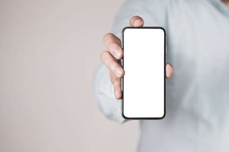 Businessman holding smartphone  for add text wording or message or mockup advertisement with copy space.
