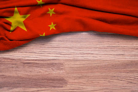 Crumpled of Republic of China flag on wooden background.