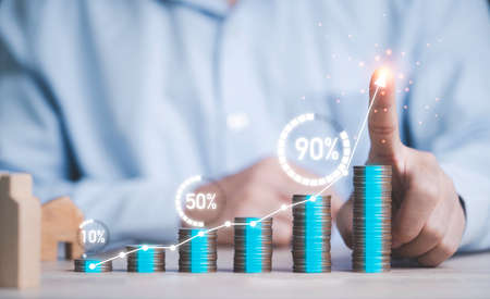 Businessman writing chart on growth coin stacking with virtual circle percentage loading , deposit money saving and business profit increasing concept. Zdjęcie Seryjne
