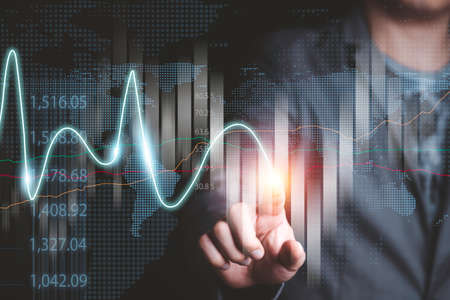Stock market investment and business growth concept , Businessman trader writing stock market investment chart for analysis.