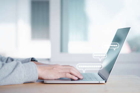 Businessman using computer laptop to send message for communicate. 版權商用圖片