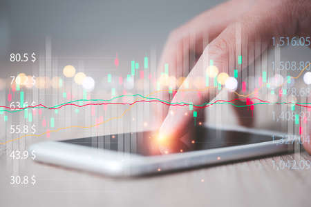 Trader hand touching on screen of smartphone to analysis technical stock market chart , value investor concept.