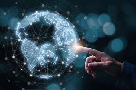 Businessman touching to virtual world with connection line for global networks and technology linkage concept. 版權商用圖片