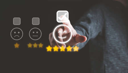 Businessman touching smile face icons and info graphic to evaluate product after use service , customer satisfaction concept.