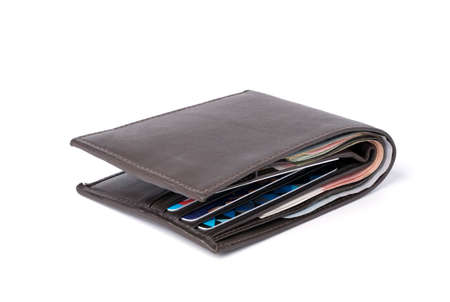 Sideview isolated of Brown leather Money wallet with banknote and credit card on white background.