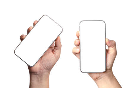 Isolated of two angels views of Hand holding smartphone with blank screen frame on white background for mockup template. Mobile phone device concept. 版權商用圖片