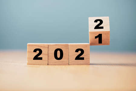 Flipping of wooden cube block for change 2021 to 2022 year , Preparation for merry Christmas and happy new year concept. 版權商用圖片
