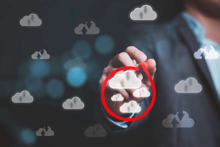 Businessman drawing red circle mark to select virtual cloud computing , technology transformation change and share storage concept.