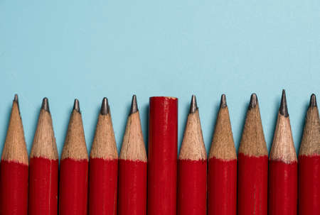 The end of one red pencil is switched to the tip of the red pencil group , Disruption different thinking and leadership concept.