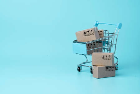 Isolated of Shipping paper boxes blue background and copy space , Online shopping and e-commerce concept.