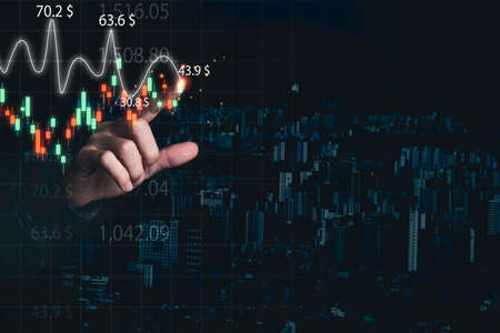 Stock market investment and business growth concept , Businessman touching to stock market investment candle stick chart.