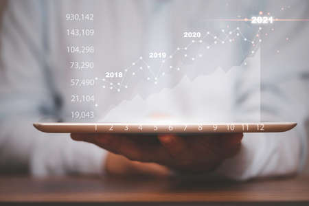 Businessman holding tablet with stock market chart and graph , Value investor analysis for trading concept. 스톡 콘텐츠 - 166426569