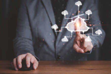 Businessman touching virtual cloud computing with connect to technology icons