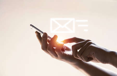 Hands and virtual letter icon with mobile phone for send email