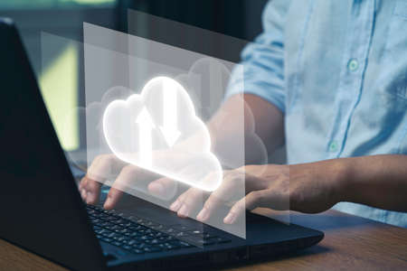 Virtual Cloud and technology icons , Businessman using laptop computer to control operations thru cloud computing system.