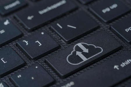 White cloud computing icon print screen on black laptop computer keyboard , Technology transformation and upload download concept. 스톡 콘텐츠