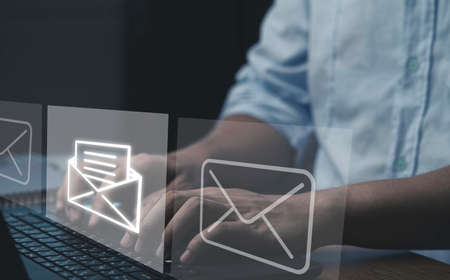 Businessman typing laptop computer to open and send email to customer, business contact and communication concept.