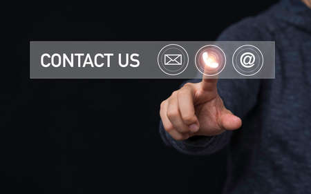 Businessman touching to virtual mobile phone among e-mail and address for business contact and customer service concept. 스톡 콘텐츠