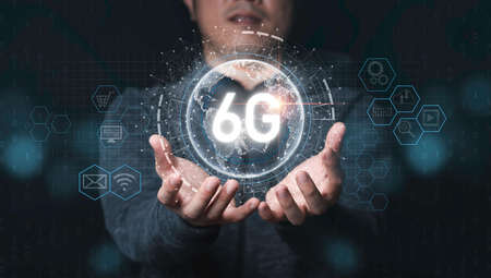 Businessman holding world with 6G and connection line infographic technology icons , 6G is six generation of high speed internet technology which will change communication and lifestyle in the future. 스톡 콘텐츠