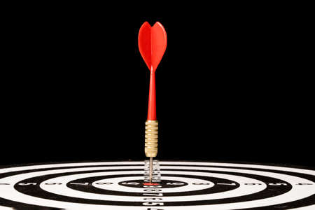 Red Dart arrow hit dartboard and goal on black background ,Setup objectives and target for business investment concept.