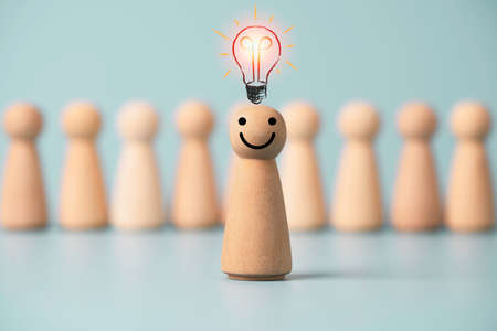 Wooden figure with drawing light bulb standing in front of other wooden with question mark , Problem solving and creative idea  concept. Zdjęcie Seryjne