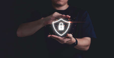 Man hand protect virtual key lock for data security information and technology concept. Zdjęcie Seryjne