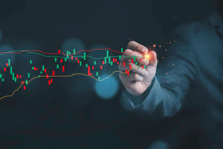 Stock market investment and business growth concept , Businessman writing stock market investment chart with increase green arrow. Zdjęcie Seryjne