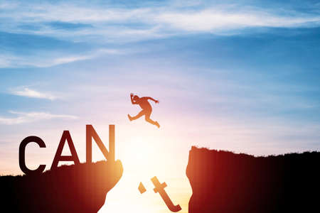 silhouette man jumping from can't cliff to can cliff , Change Mindset concept.