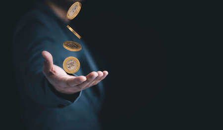 Business hand receiving coin falling with copy space , Earning and profit investment concept. Zdjęcie Seryjne