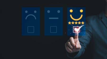 Businessman  touch on virtual tab bar to customer evaluates products and services. Customer satisfaction and marketing survey rating concept.