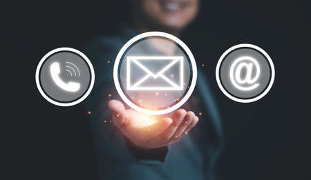 Businessman holding newsletter icon among telephone and address icon , Business contact concept.