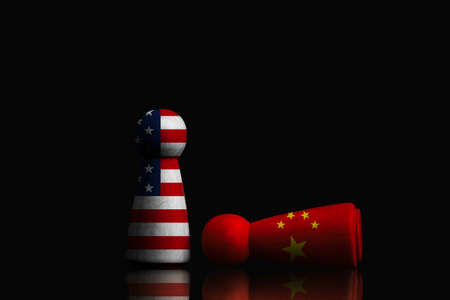 China figure falling and USA figure standing on dark background , China and United States of America technology and trade war concept. Zdjęcie Seryjne