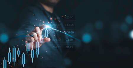 Businessman touching to stock market chart and graph for analysis investment, trader and value investor concept. Zdjęcie Seryjne