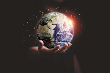 Man holding planet by hand for earth day and saving energy environment concept 스톡 콘텐츠