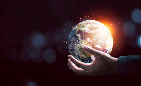 Earth inside of two hands for earth day and saving energy environment concept