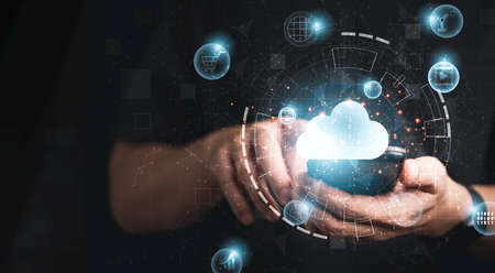 Businessman using smartphone with virtual cloud computing technology transformation and internet of thing. Cloud technology management big data include business strategy , customer service.