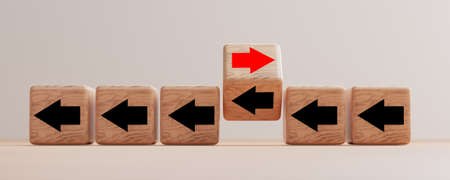 Flipping wooden cube block arrow from change left to right for business disruption and different thinking idea by 3d render.