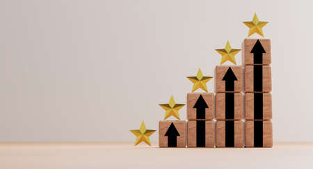Golden five stars on wooden stacking with rise up arrow for client excellent rating and customer evaluation of product service concept. 스톡 콘텐츠