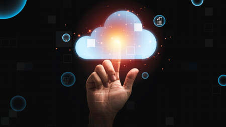 Man hand touching virtual cloud computing for download  upload data information , Technology transformation concept. Banque d'images