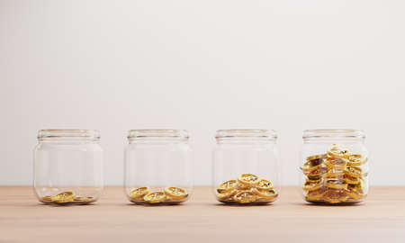 Golden coins increasing inside of transparent jar on table for investment and banking financial saving deposit concept by 3d rendering. Banque d'images
