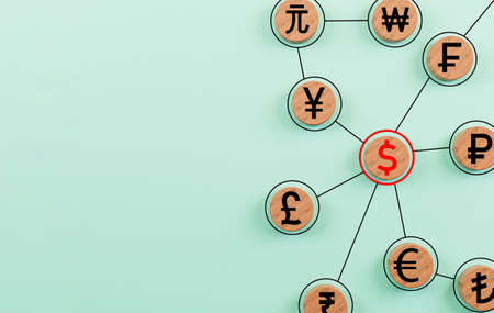 Currency sign print screen on circle wooden block and together linkage on blue background for financial banking and currency trading forex concept by 3d rendering. Banque d'images