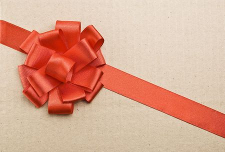 Gift packaging with red ribbons and bow on cardboard background Stock Photo - 5541612