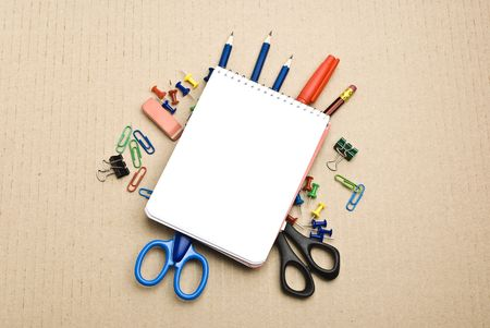 Office tools on cardboard background Stock Photo